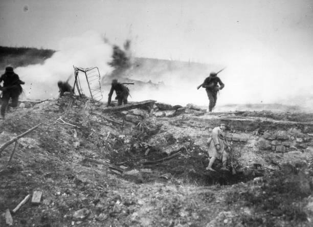 German troops advance across open ground at Villers-Bretonneux...