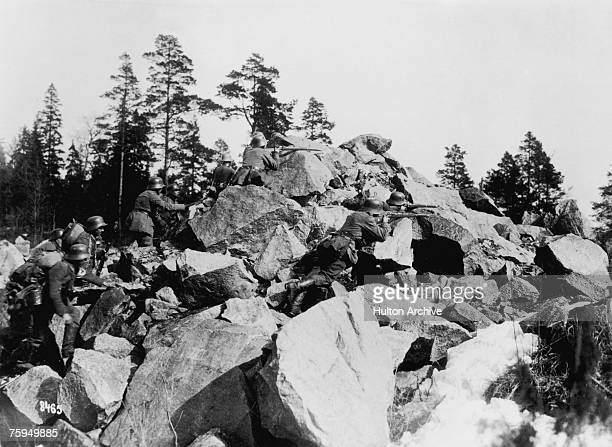 German troops allied with the Finnish White Guard fighting communist forces of the Red Guard during the advance on Helsingfors Finland during the...