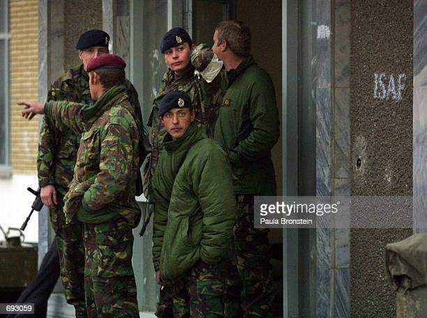 German troops check out their surroundings after arriving at their barracks January 11, 2002 outside of Kabul. The peacekeeping troops are in...