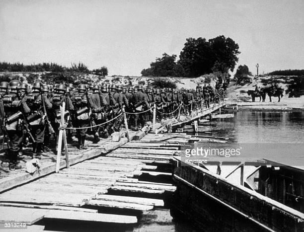German troops crossing the River San by pontoon bridge during their invasion of Poland