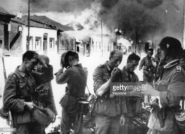 German troops entering the Russian town of Vitebsk on the way to Moscow only to find it deserted and ablaze