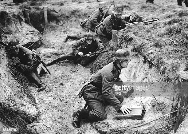 German troops in a trench during closecombat training at a military academy in Doberitz Germany 21st December 1938