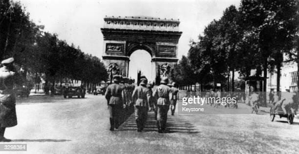 German troops marching along the Champs Elysees, Paris, towards the Arc de Triomphe.