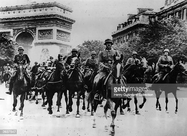 German troops riding through Paris with the Arc de Triomphe in the background