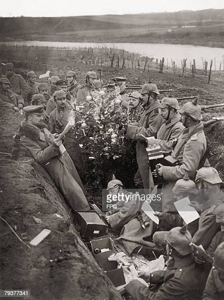 German troops singing around a Christmas tree in their trench on the Eastern Front during World War I circa 1915