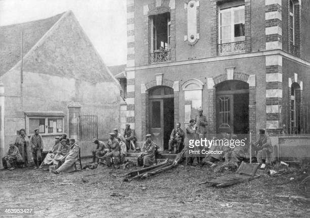 German troops sitting on the steps of the Vareddes Town Hall France 1914 German soldiers taking a rest during the First Battle of the Marne