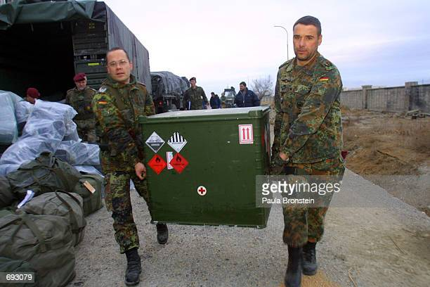 German troops unload their trucks after arriving at their barracks January 11, 2002 outside of Kabul. The peacekeeping troops are in Afghanistan as...