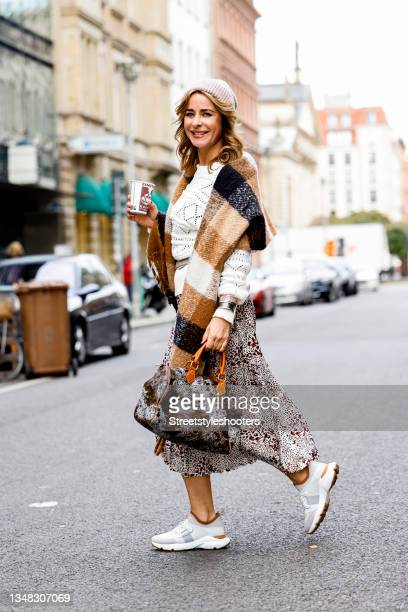 German TV host and communication manager Bettina Cramer, wearing a white pullover by Vila, a white, red and black patterned skirt by Vila, a brown...
