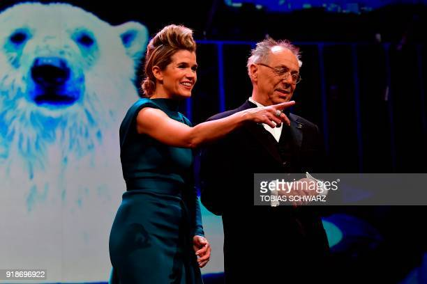 German TV host Anke Engelke and Berlinale Director Dieter Kosslick stand on stage during the opening ceremony of the 68th Berlinale film festival...