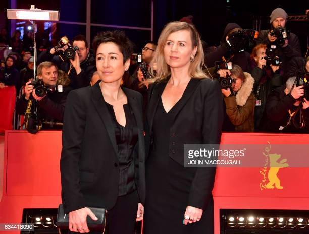 """German TV host Dunja Hayali and Pamela Schobess arrive for the opening of the Berlinale film festival with the premiere of """"Django"""" during the 67th..."""
