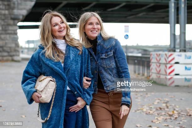 German TV host Frauke Ludowig wearing a long blue coat by Semperlei, a white turtleneck pullover by Semperlei, dark blue denim jeans by Semperlei and...