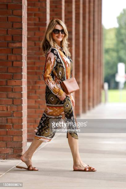 German TV host Frauke Ludowig wearing a long multicolored tunic dress with different pattern by Funky Staff, brown sandals by Hermes, a brown bag by...