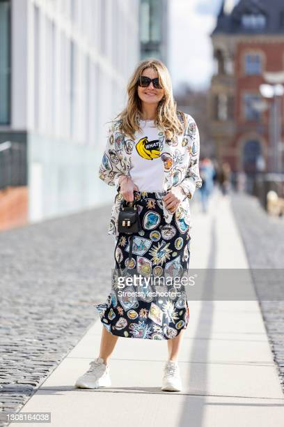 German TV host Frauke Ludowig wearing beige and white sneaker by Copenhagen Studios, sunglasses by Prada, a white shirt with banana print by Ivy, a...