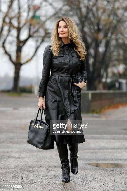 German TV host Frauke Ludowig wearing black knee high boots by Steffen Schraut, a black midi length leather dress by Riani and a black bag by Hermes...