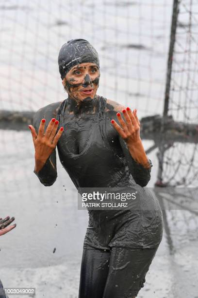 German TV host Panagiota Petridou covered with mud react during the 2018/2019 Wattoluempiade on July 21 2018 in Brunsbuettel Germany Around 400...