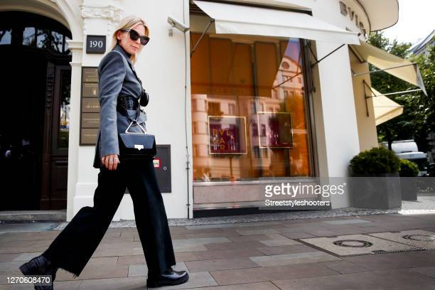 German TV host Tamara von Nayhauss wearing a black turtleneck pullover by Sly010, a grey blazer by Sly010, a black belt by Sly010, a black crossbody...
