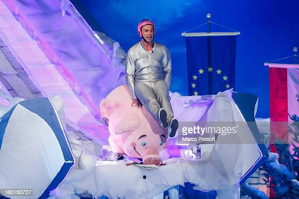 German TV presenter Florian Silbereisen jumps off a ski jump during the 'Winterfest der fliegenden Stars' TVShow on January 26 2013 at the...