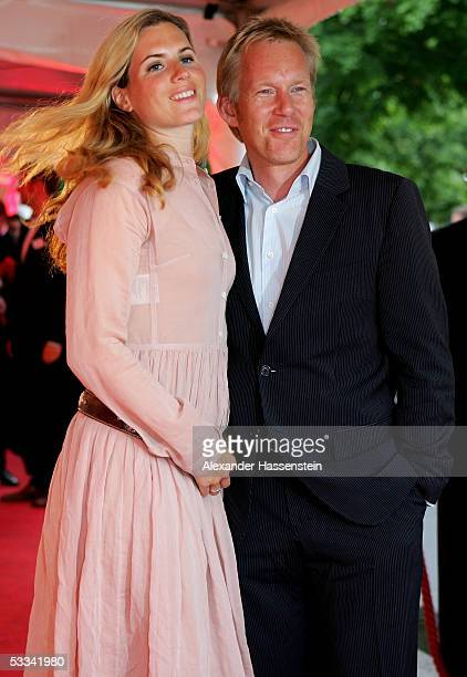 German TV Presenter Johannes B Kerner poses with his wife Britta Becker during the ceremony of the Sport Bild Award 2005 at the Restaurant Insel am...