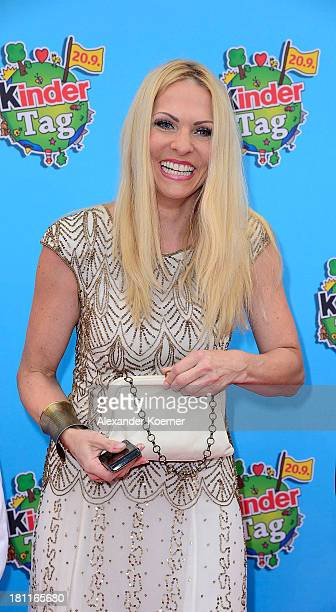 German TV presenter Sonya Kraus shows here purse which is filled with chocolate during the red carpet prior the Ferrero kinderTag 2013 event at...