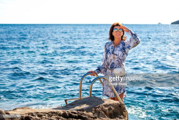 German TV star Claudia Obert poses at the beach during an exclusive shooting on August 8, 2020 in Ibiza, Spain.