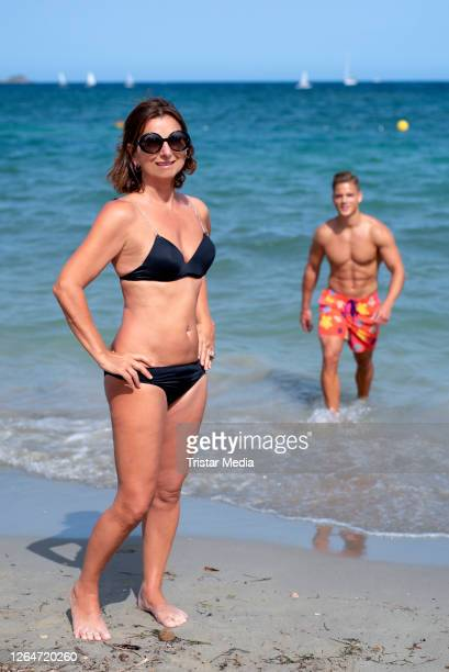 German TV star Claudia Obert poses at the beach with Cedric Beidinger during an exclusive shooting on August 8, 2020 in Ibiza, Spain.
