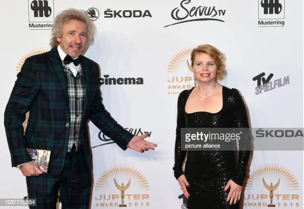German TVhost Thomas Gottschalk and comedian Annette Frier arrive for the Jupiter Award ceremony at the Cafe Moskau in Berlin Germany 25 March 2015...