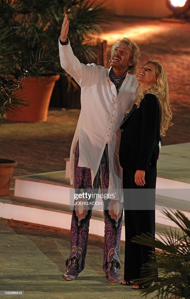 German tv-host Thomas Gottschalk and his co-host Swiss model Michelle Hunziker are pictured during the television show 'Wetten, dass..?' (Let's Make a Bet) at the 'Coliseo Balear' bull fighting arena in Palma de Mallorca on the Balaeric Island of Mallorca on May 23, 2010.
