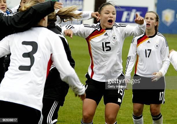German U17 team players Luisa Wensing Silvana Chojnowski and Annabel Jaeger celebrate after winning France in Women's Euro qualifying match between...