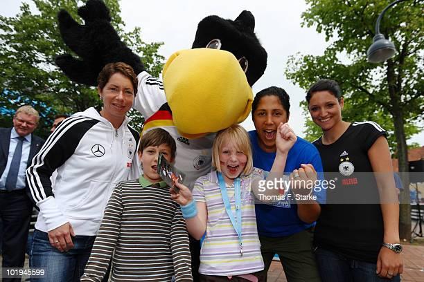 German U20 Women's head coach Maren Meinert mascot Paule Steffi Jones head of the Organising Committee of the FIFA Women's World Cup 2011 and German...