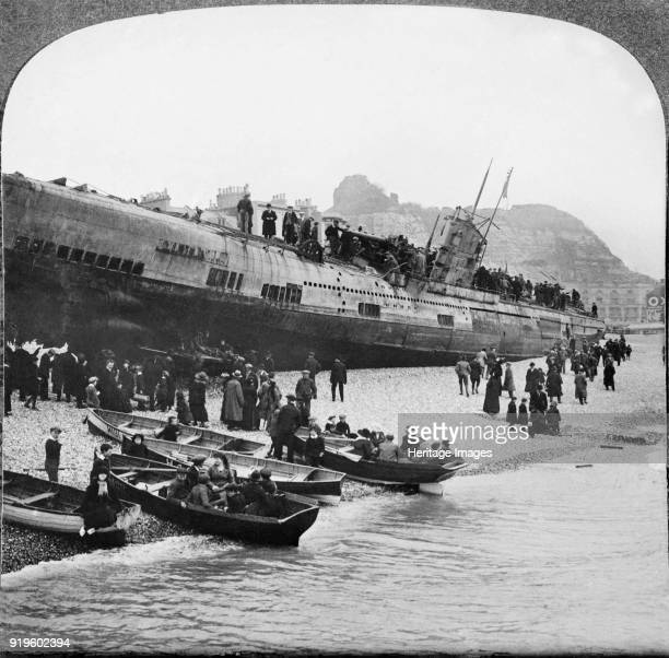 German Uboat U118 aground on Hastings Beach Sussex 1919 People in rowing boats and on the beach looking up at the submarine which ran aground on...