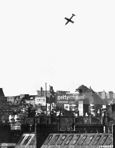 A German V1 flying bomb is about to land on a residential area of southern England during World War II