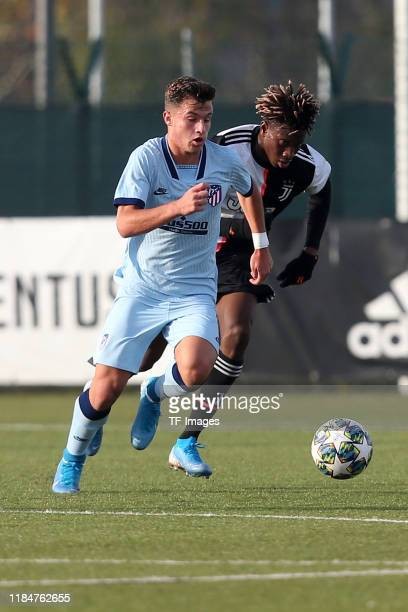 German Valera of Atletico Madrid U19 and Mamadou Kaly Sene of Juventus Turin U19 battle for the ball during the UEFA Youth League match between...