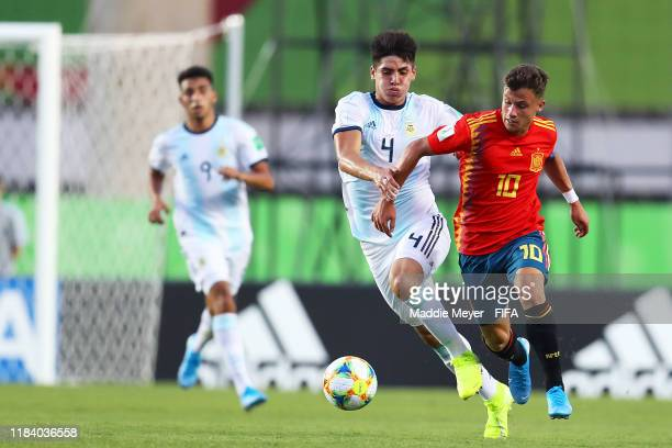 German Valera of Spain and Kevin Lomonaco of Argentina battle for control of the ball during the FIFA U17 World Cup Brazil 2019 group E match between...