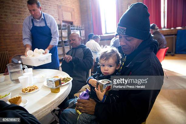 German Veliz and his son Asher eat a Thanksgiving dinner at the St Vincent DePaul soup kitchen The Portland Rotary Club has been putting on and...
