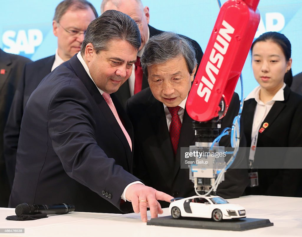 German Vice Chancellor and Economy and Energy Minister Sigmar Gabriel (L) and Chinese Vice Premier Ma Kai look at a robot with networked maintenance at the SAP stand while touring the 2015 CeBIT technology trade fair on March 16, 2015 in Hanover, Germany. China is this year's CeBIT partner. CeBIT is the world's largest tech fair and will be open from March 16 through March 20.