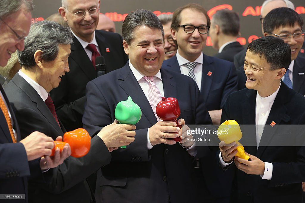 German Vice Chancellor and Economy and Energy Minister Sigmar Gabriel (C) and Chinese Vice Premier Ma Kai (L) receive gifts from Alibaba Group Executive Chairman Jack Ma (R) while touring the 2015 CeBIT technology trade fair on March 16, 2015 in Hanover, Germany. China is this year's CeBIT partner. CeBIT is the world's largest tech fair and will be open from March 16 through March 20.