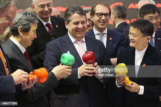 German Vice Chancellor and Economy and Energy Minister Sigmar Gabriel and Chinese Vice Premier Ma Kai receive gifts from Alibaba Group Executive...