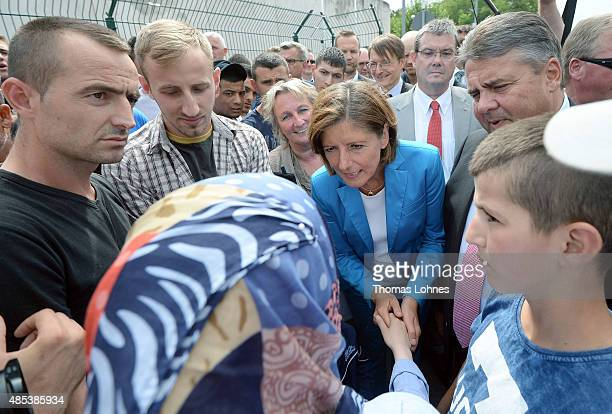 German Vice Chancellor and Economy and Energy Minister Sigmar Gabriel and Rhineland-Palatinate Governor Malu Dreyer speak with Albanian migrants...