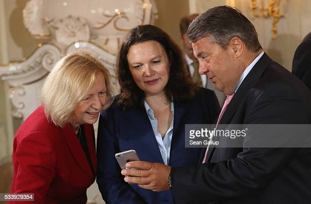 German Vice Chancellor and Economy and Energy Minister Sigmar Gabriel shows Education Minister Johanna Wanka and Minister of Work and Social Issues...
