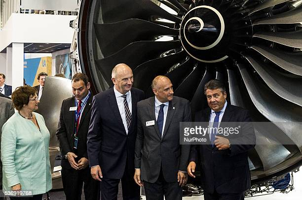 German Vice Chancellor and Economy and Energy Minister Sigmar Gabriel and Brandenburg Governor Dietmar Woidke stand under a jet turbine while...