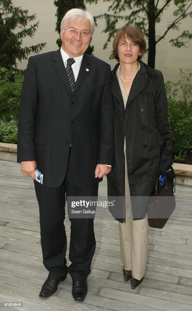German Vice Chancellor and Foreign Minister Frank-Walter Steinmeier and his wife Elke attend the opening of the new U.S. embassy on July 4, 2008 in Berlin, Germany. Architectural critics claim the embassy, designed by American architect Moore Ruble Yudell, offers little in architectural innovation or design.