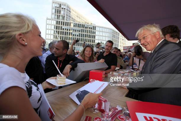 German Vice Chancellor and Foreign Minister FrankWalter Steinmeier distributes autographs during the presentation of the new red box for the SPD...