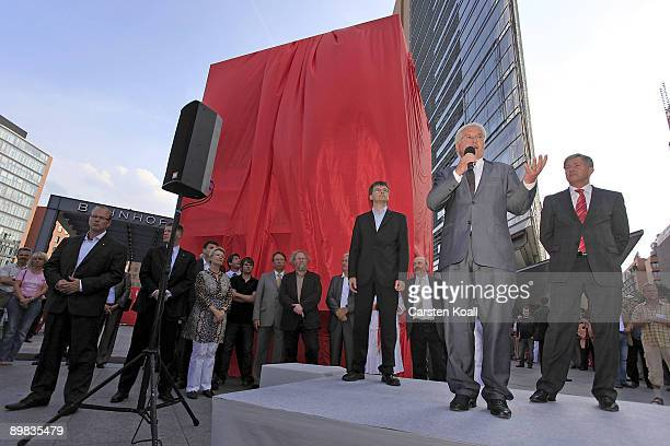 German Vice Chancellor and Foreign Minister FrankWalter Steinmeier speaks beside Berlin's Major Klaus Wowereit during the presentation of the new red...