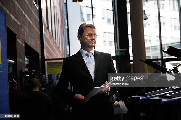 German Vice Chancellor and Foreign Minister Guido Westerwelle and leader of the German Free Democrats political party arrives to speak to the media...