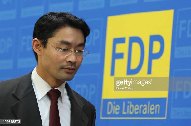German Vice Chancellor Economy Minister and Chairman of the German Free Democrats political party Philipp Roesler departs after speaking to the media...