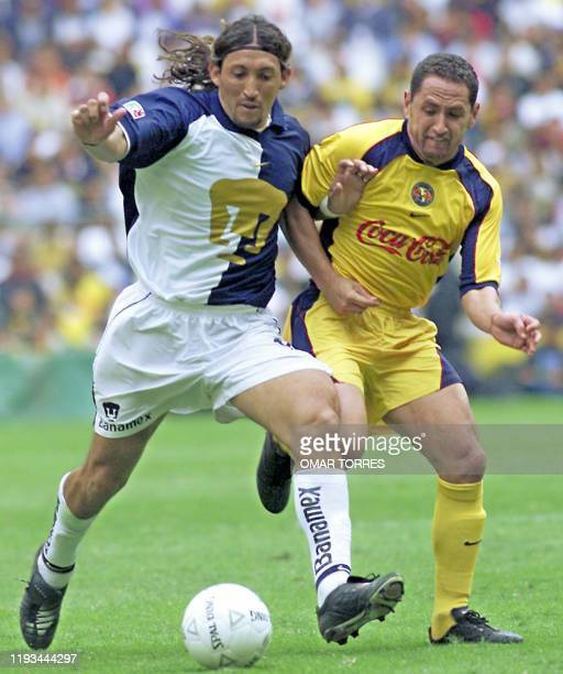 German Villa, of America team, fights Victor Müller, of the Pumas , 24 February 2002, during the Torneo de Verano competition in the Azteca stadium...