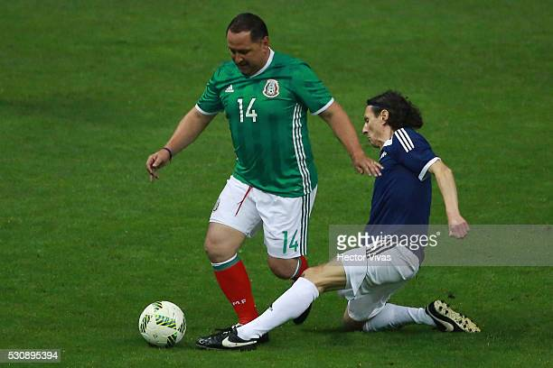 German Villa of Mexico's All Star Team struggles for the ball with Aleksei Smertin of FIFA Football Legends during the FIFA Football Legends Match...