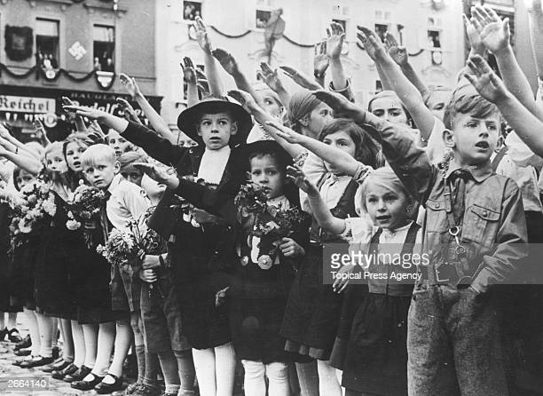German village children in Eger giving the Nazi salute as Hitler takes over the Sudetenland