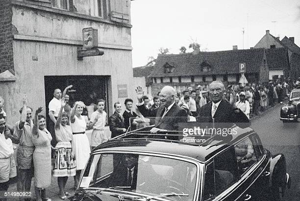 German Villagers Cheer President. Bonn, West Germany: President Eisenhower and West German chancellor Konrad Adenauer wave to enthusiastic villagers...