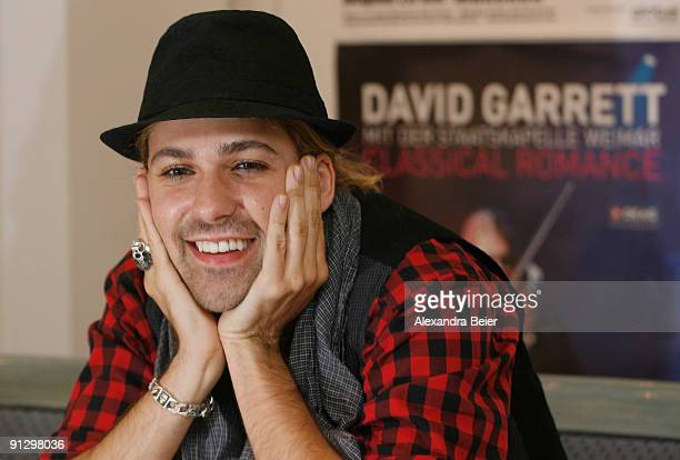German violinist David Garrett smiles during a news conference to present his his DVD 'David Garrett Live - in Concert & in Private' on October 1,...